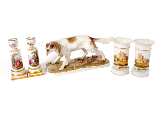 A Nymphenburg figure of a dog, a pair of continental vases and a pair of 19th century Meissen candlesticks