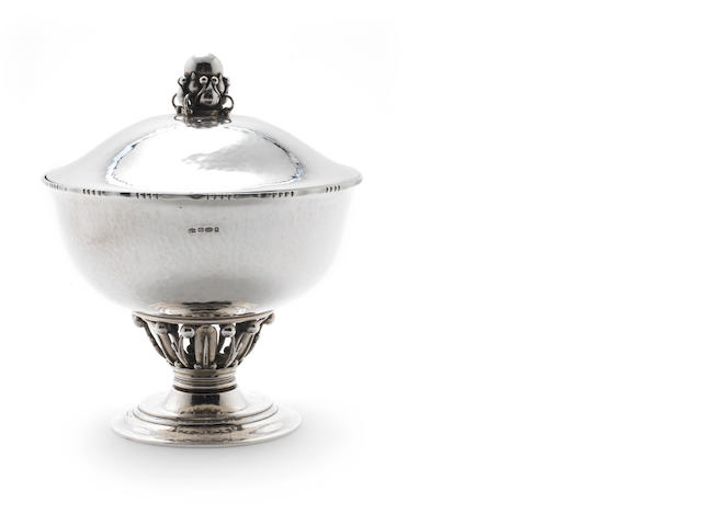 GEORG JENSEN: A silver lidded 'Louvre' bowl by Georg Jensen, Denmark Stirling 1915-1927, '180c', Assay master Christian F. Heise (1904-32), with additional French import swan mark, and London import marks for Stockwell & Co, 1923