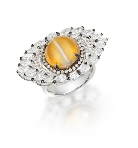 A cat's eye chrysoberyl and diamond ring