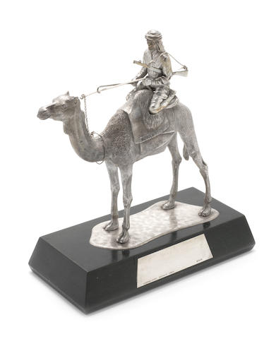 ASPREY: A silver model of a soldier on Camel back base of camel with lion passant and town mark only visible, engraved Algernon Asprey Ltd, only date letter visible on applied plaque, London 1973