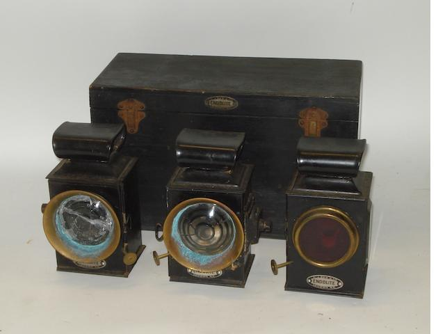 A cased set of three Endolite emergency motoring oil-lamps, by A J Dew & Co,