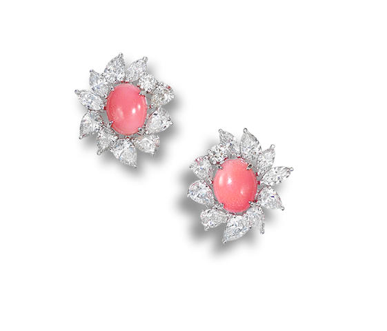 A pair of conch pearl and diamond earrings