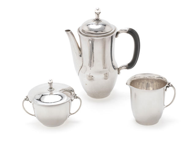 HARALD NIELSEN for GEORGE JENSEN: A silver three-piece coffee service, Design number 456 Denmark, the coffee pot and sugar bowl with import marks for Georg Stockwell, London 1928 and 1930 the cream jug with import marks for Georg Jensen Ltd, London 1947  (3)