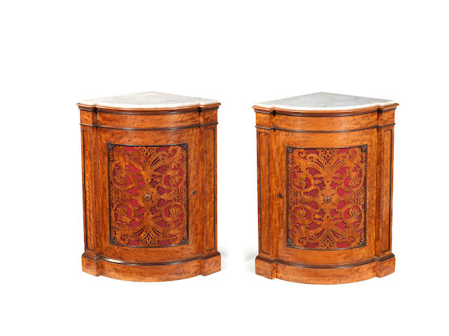 A pair of William IV satinwood and purplewood encoignures in the manner of Gillows