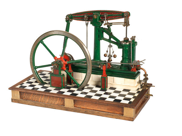 A well engineered 1in : 1ft scale model of a Sanderson single cylinder pillar beam engine of circa 1856 Built by J.E Ginn 1980s