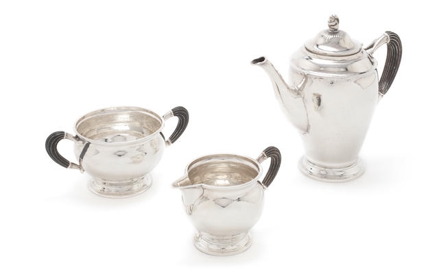 A Danish silver three-piece coffee service pot, Copenhagen 1930, with assay masters mark for C F Heise, the cream and two-handled sugar bowl, Copenhagen 1932, with assay masters mark for J Sigsgaard  (3)
