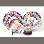 A pair of Imari wall plaques, a plate and a bowl Circa 1900