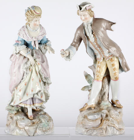 A pair of German porcelain figures