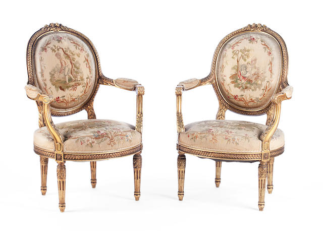 A pair of carved giltwood fauteuils