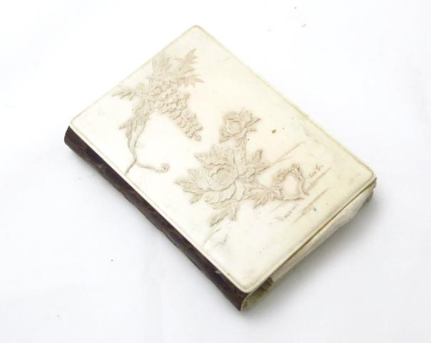 A carved ivory card case Circa 1900