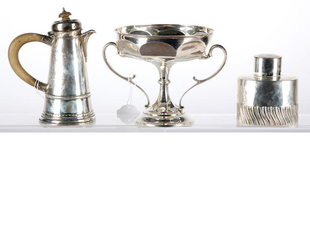 A silver teapoy, a twin handled pedestal cup and a hot water pot.