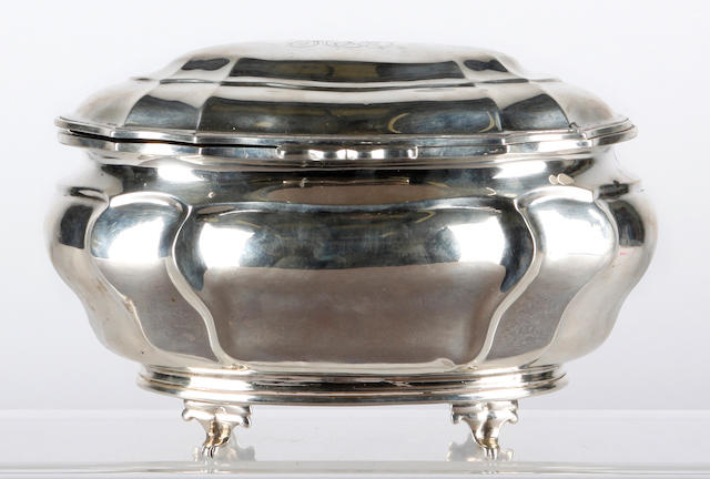 A silver biscuit box of lobed form