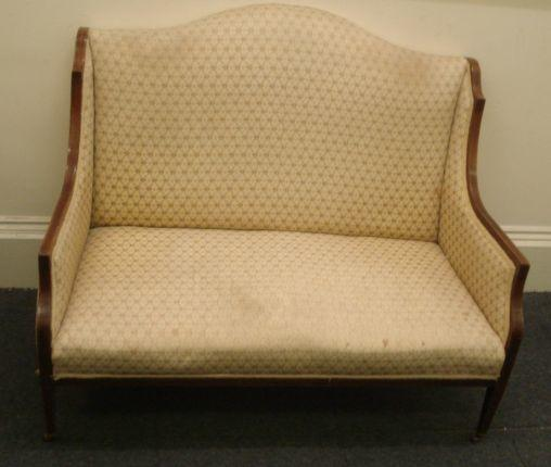 An Edwardian mahogany boxwood strung upholstered two seat salon settee, on tapered legs, 125cm.