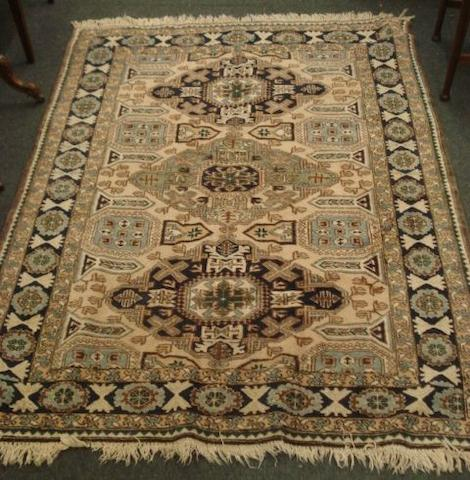 An Afgan rug, geometric pattern, on a rust ground, 2.9 x 1.65m, worn and three other rugs.(4)