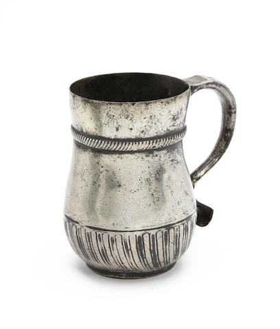 An extremely rare and fine tulip-shaped gadrooned mug of ale-pint capacity, circa 1710