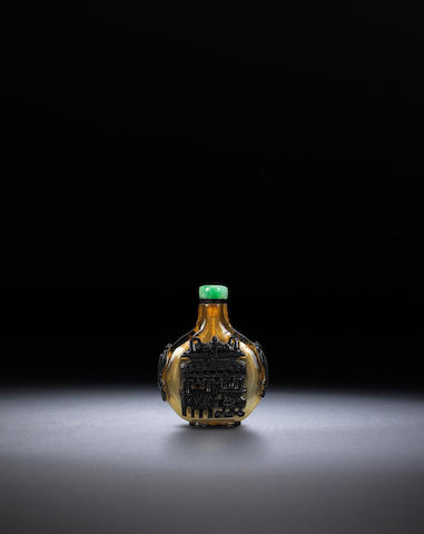 A black glass overlay 'archaic bronze' snuff bottle Late Qing dynasty