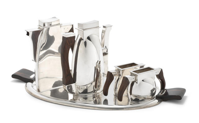 A sterling silver four-piece tea / coffee service together with a tray unidentified