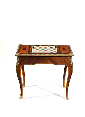 A Victorian kingwood and gilt metal mounted games table, with specimen marble inset chess board