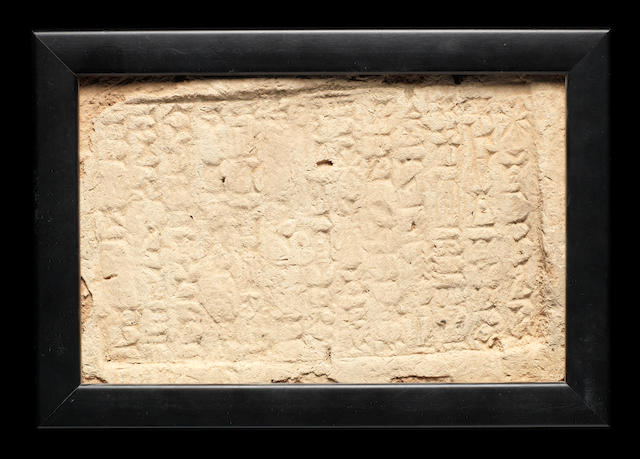 A Mesopotamian cuneiform inscribed clay brick