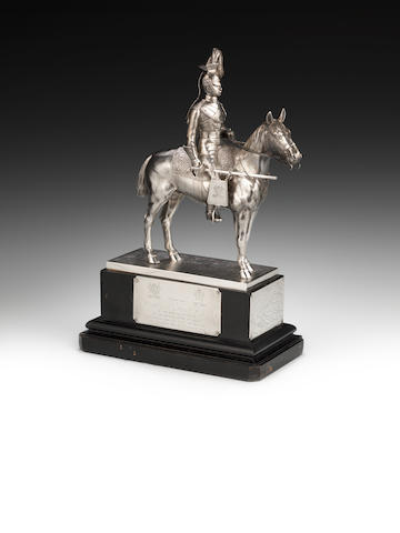 A silver standing model of a Royal Irish 5th Regiment/Queens Lancers soldier on horseback by Goldsmiths & Silversmiths, London 1946