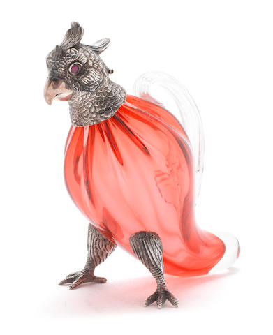 A silver mounted cranberry coloured glass novelty parrot liquor decanter by Hampton Utilities, Birmingham 2001