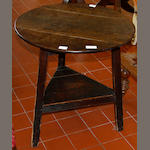An antique oak and pine cricket table