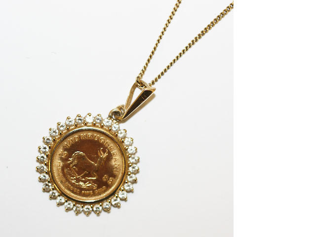 A coin pendant and chain,