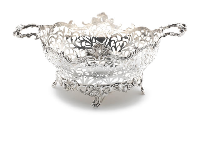 A silver two-handled basket by William Comyns London 1904