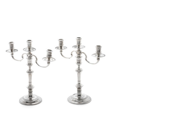 A pair of silver three-light candelabrum by R Comyns London 1956