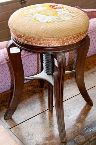 A Victorian mahogany adjustable revolving piano stool