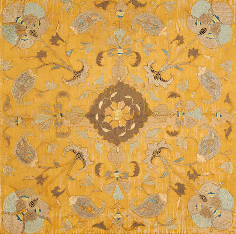 A Safavid embroidery decorated with silk and metal thread flowers on a yellow silk ground Iran, early 18th Century