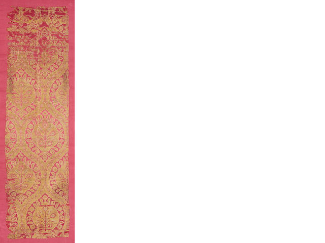 An Ottoman gilt metal embroidered red silk panel with ogival design Turkey, 18th Century