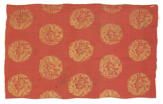 Two Lao or Jin silk fragments with gold dragons and pearls in medallions on a red ground China, 11th/12th Century