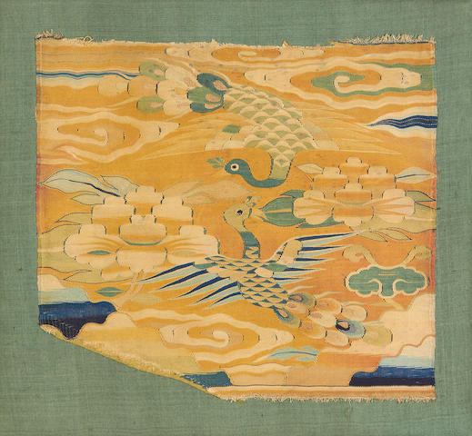 A Ming dynasty rank badge for a civil official's costume decorated with peacocks and worked in tapestry  China, 16th/17th Century