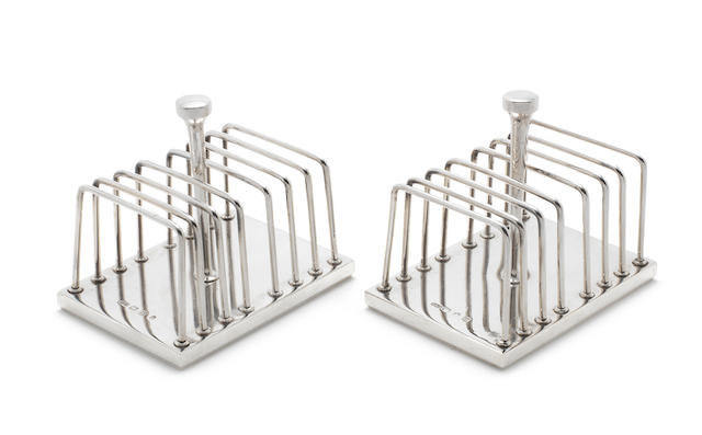 JOHN ALISTAIR DONALD: A pair of silver toast racks London 1973