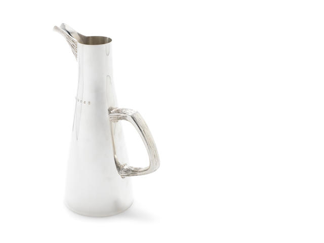 HOUSE OF LAWRIAN: A silver pitcher London 1977