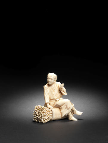 An ivory okimono of a wood-man By Shizusada, Meiji Period