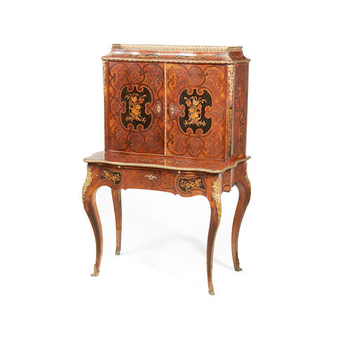 A French late 19th century tulipwood, amaranth, ebonised and fruitwood marquetry serpentine bonheur du jour in the Louis XV style