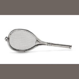 A novelty silver cocktail strainer, in the form of a tennis racket by Grey & Co, Birmingham 1907, also with incuse Rd number 510385