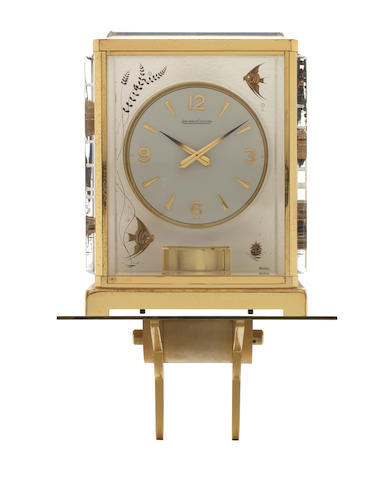 A Jaeger-Le-Coultre 'Marina Aquarium' Lucite Atmos Clock with wall bracket signed