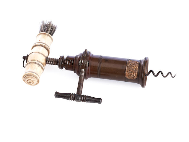 A 19th century bronzed metal and ivory patent corkscrew