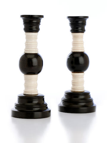A pair of early 19th century Anglo-Indian ebony and ivory candlesticks