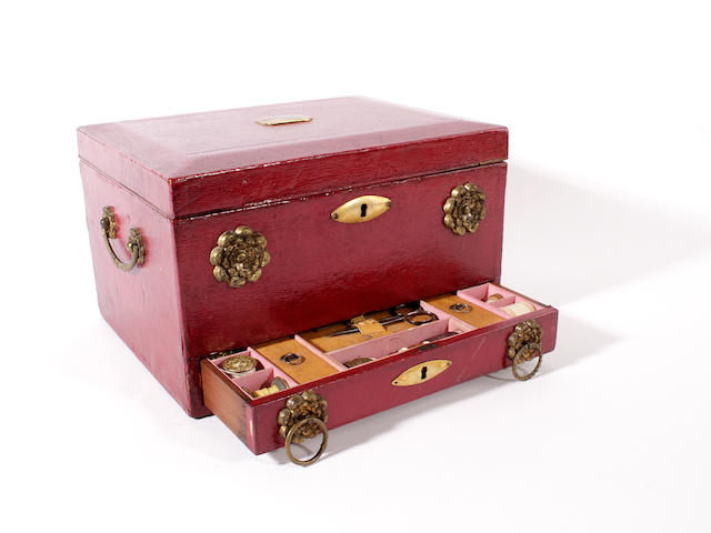 An early 19th century English red leather sewing box