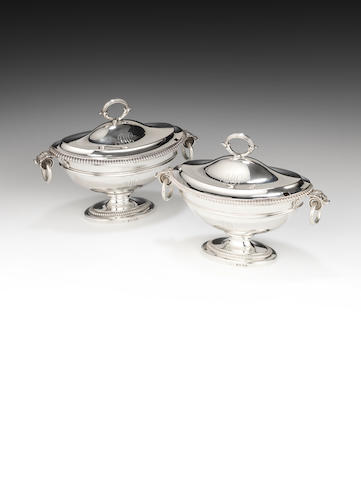 A pair of Paul Storr silver sauce tureens and covers.