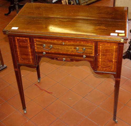 An Edwardian inlaid mahogany games table.