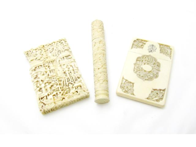 Two Canton export ivory card cases and a needle case 19th century