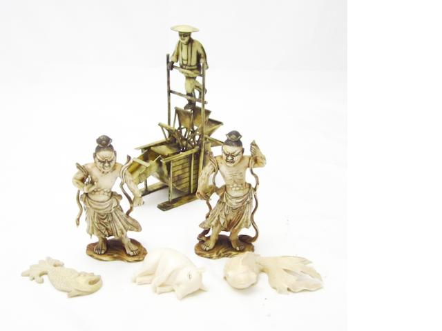 A pair of ivory demons, three other small ivories and one resin okimono Circa 1900