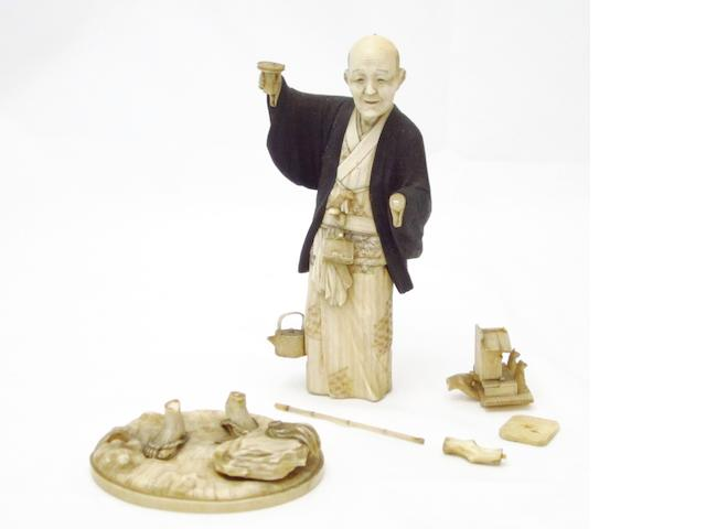 A boxwood and ivory okimono by Kouju Meiji