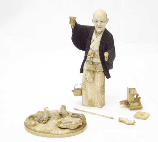 A boxwood and ivory okimono by Kouju Meiji
