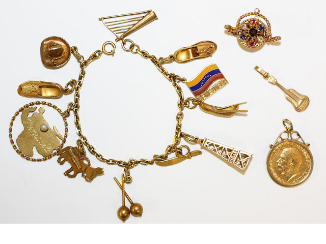 A charm bracelet, a sovereign pendant and two charms, (4)
